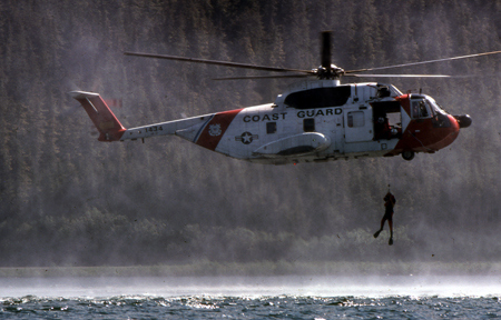 In Kodiak, Alaska, the crew of a Coast Guard helicopter train in search and rescue technique.
